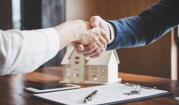 handshake among professionals over a property deal